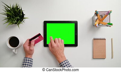 Man's Hands Touching i-Pad and Holding Credit Card - A man's...