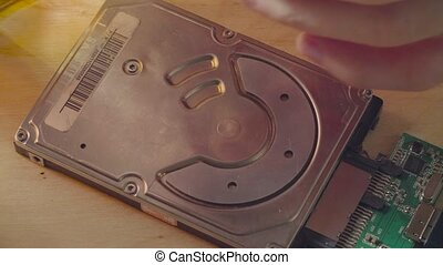 Man's hands unscrewing the hdd cover - Macro shooting of...