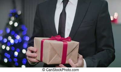 Man's Hands Unwrapping a Christmas Gift