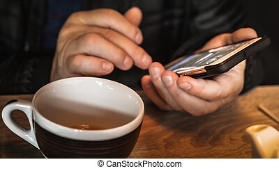 man's hands with a smartphone