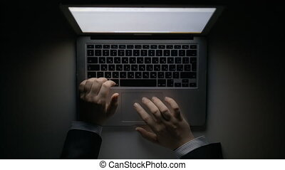 Man's Hands Working on the Laptop at Night - A man's hands...