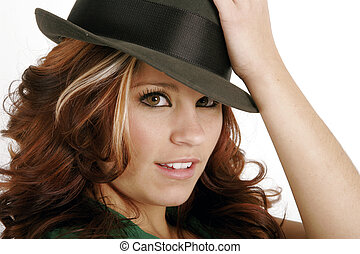 Pretty young woman in a man's hat