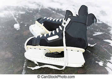 Man's hockey skates on ice. Ice skating outdoors on a freezing winter
