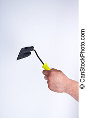 Man's holding one-handed steel hoe tool.