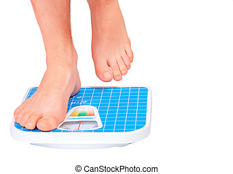 Man's legs ,which weighed on floor scale. Isolated - Man's...