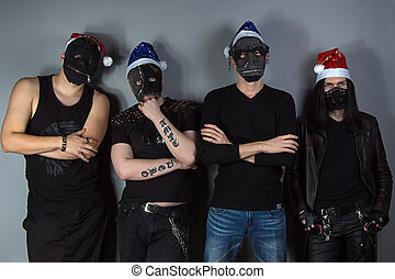 Man's metal band in christmas hats