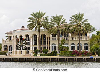 Mansion and Three Palms at Christmas - A large mansion on a...