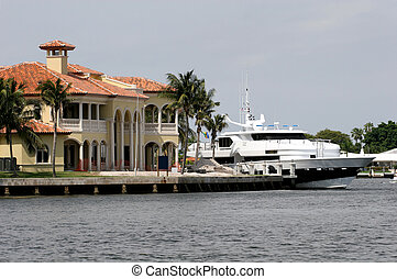 Mansion and Yacht - A mansion on the canal with a yacht tied...