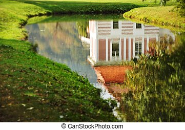 Mansion reflection in pond