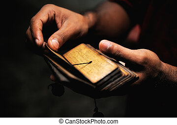 Mantra - Ancient Tibetan Buddhist text in the hands of...