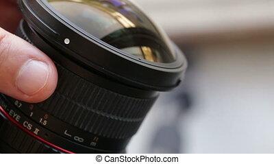 Manual focus of the camera lens. Closeup.