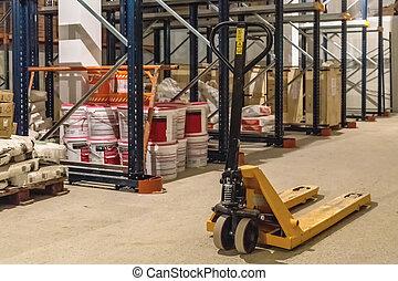 Manual forklift pallet stacker truck equipment in warehouse