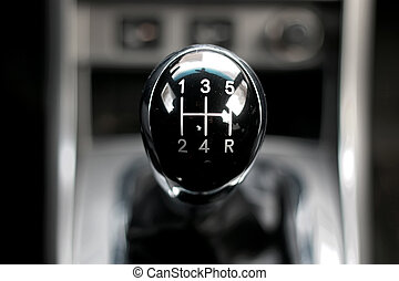 manual gearbox in the car - black shiny handle manual...