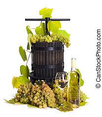 Manual grape pressing utensil with white wine