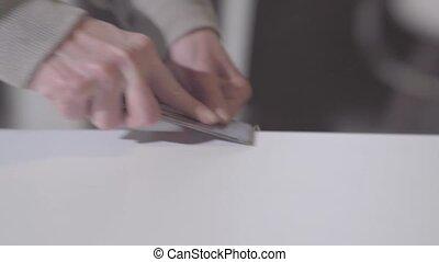 manual grinding of furniture edges.