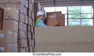 Manual Labor - Close up of worker uncarting load and...