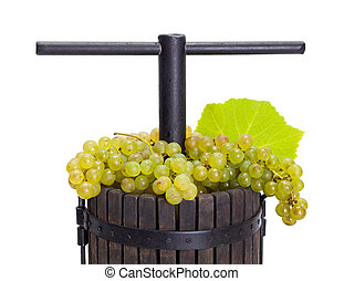 Manual pressing utensil filled with white grape
