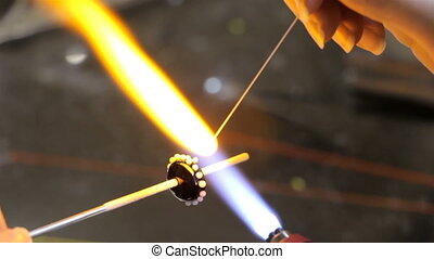 Manual production of glass bead, sixteenth video