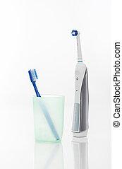 Manual Regular Toothbrush Against Modern Electric Toothbrush