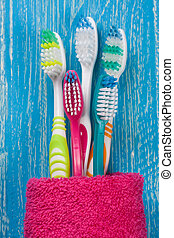 toothbrushes on the blue wooden background