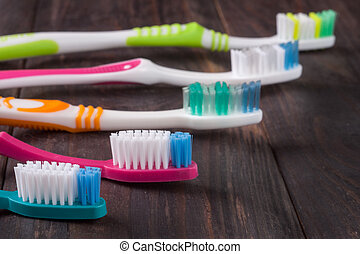 manual toothbrushes on the dark wooden background