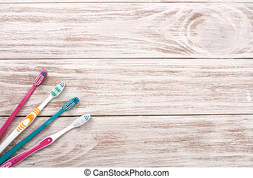 manual toothbrushes on the old wooden background with copy space for your text. Top view