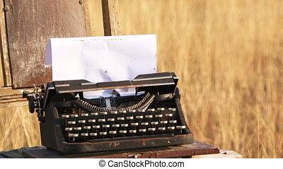 Manual Vintage Typewriter  With Sheet Of Paper At Nature