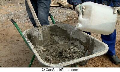 Manual wheelbarrow with concrete