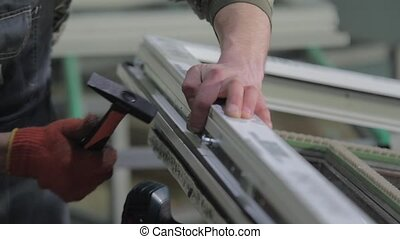 Manual worker assembling PVC doors and windows. - Kyiv,...