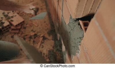 Manual Worker Hands Holding Tool Near Brick Wall Closeup