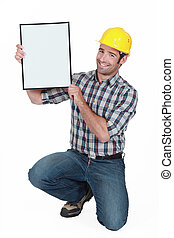 Manual worker holding a blank poster.