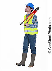Manual worker holding bolt-cutters