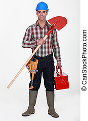 Manual worker holding spade