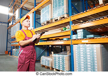 manual worker inspector in warehouse - one young worker...