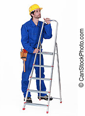 Manual worker stood with step-ladder