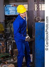 manual worker using big hammer