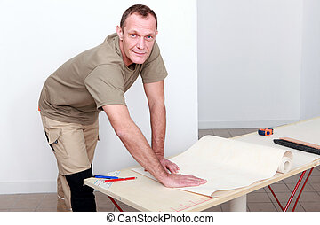 Manual worker wallpapering