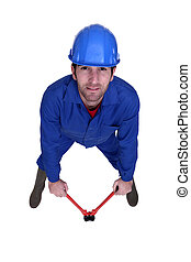 Manual worker with a pair of bolt cutters