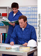 Manual workers in an office