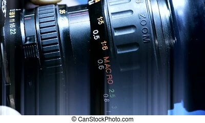 Manually adjust camera lens.