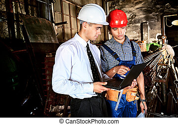 manufacture - An architecture and worker at a manufacturing...