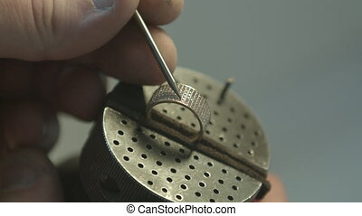 Manufacture of a ring. Work on the details of the master
