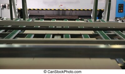 Manufacture of cardboard boxes. - Closeup image of pleat...