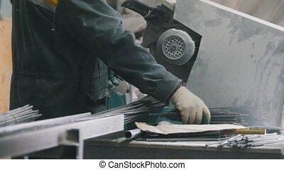 Manufacture of composite fiberglass reinforcement - worker...