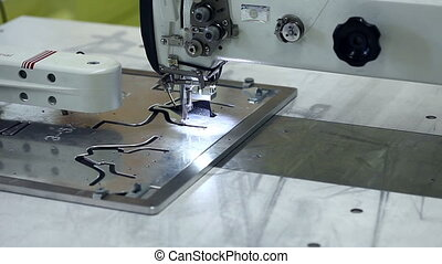 Manufacture of footwear using sewing machine