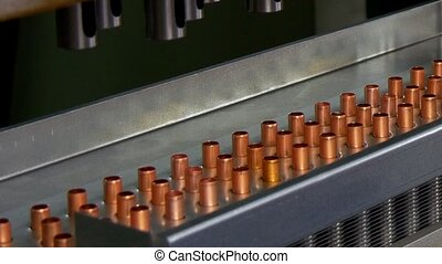 Manufacture of metal copper pipes on industrial CNC machine....