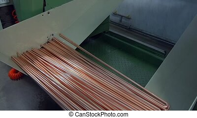 Manufacture of metal tubes on industrial CNC machine slow motion.