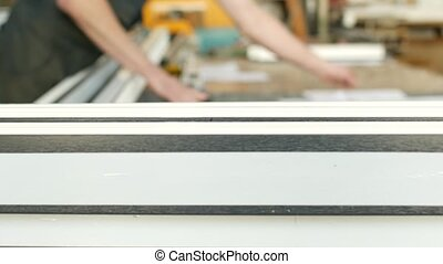 Manufacture of PVC windows, the male worker checks the...
