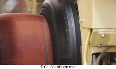 Manufacture of tires - Tire production machine close up. Car...