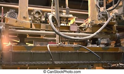 Manufacture. View of loader moves bricks, close-up -...